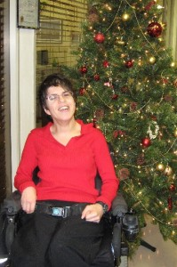 Employ-Ability Participant Lucy posing in front of a Christmas Tree
