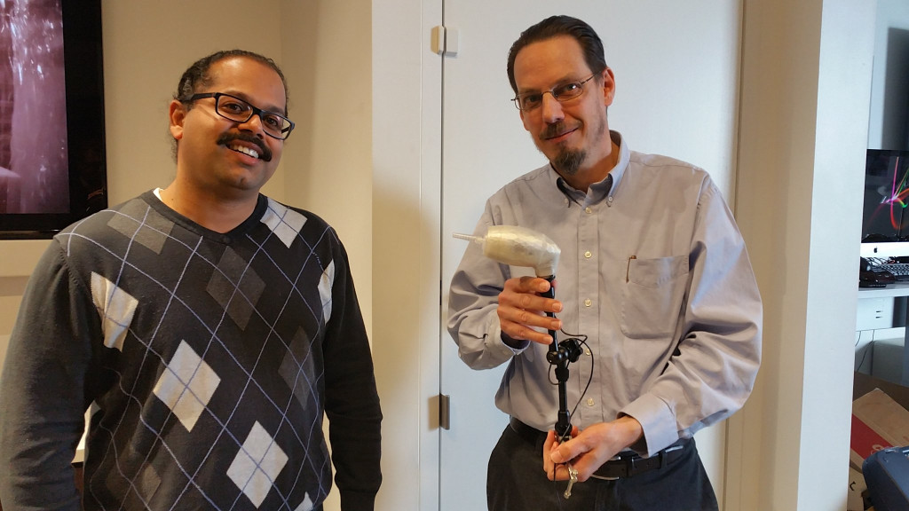 Jason and Scott, of Comcast, show off the LipSync device they built.